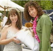 Actress Minnie Driver holding a babyinabag baby sleep sack